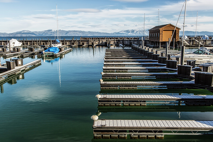 Boat dock in Lake Tahoe with mountains in the background